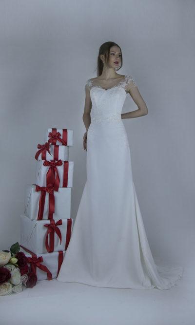 Robe de mariée ivoire d'une forme droit et sirène